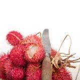 Fresh rambutan fruits. Fresh tropical rambutan fruits over rustic wood table Stock Photos