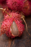 Fresh rambutan fruits. Fresh tropical rambutan fruits over rustic wood table Royalty Free Stock Photography