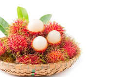 Fresh rambutan isolated. Fresh rambutan in bamboo basket isolated on white Stock Image