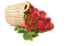 Fresh rambutan with leaf on the basket Stock Photo