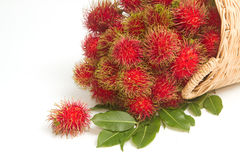 Fresh rambutan with leaf on the basket Stock Photos