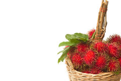 Fresh rambutan with leaf on the basket Royalty Free Stock Photo