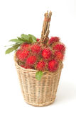 Fresh rambutan with leaf on the basket Royalty Free Stock Images