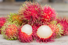 Fresh rambutan. Lot of Fresh rambutan on wood Floor Stock Photos