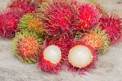 Fresh rambutan. Lot of Fresh rambutan on wood Floor Royalty Free Stock Images