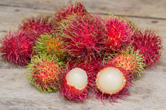 Fresh rambutan. Lot of Fresh rambutan on wood Floor Royalty Free Stock Photo