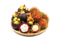 Fresh Rambutan and Mangosteen from Rayong Thailand on wooden pla. Te isolated on white background, Sweet delicious fruit Stock Photography