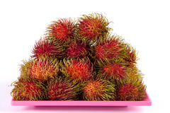 Fresh rambutan on pink dish.  Royalty Free Stock Photo