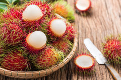 Fresh rambutan. In basket  on wood background Royalty Free Stock Images