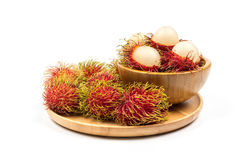 Fresh Rambutan from Rayong Thailand in wooden bowl on wooden pla Royalty Free Stock Photo