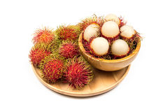 Fresh Rambutan from Rayong Thailand in wooden bowl on wooden pla Royalty Free Stock Photos
