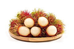 Fresh Rambutan from Rayong Thailand on wooden plate isolated on. White background, Sweet delicious fruit Royalty Free Stock Photo