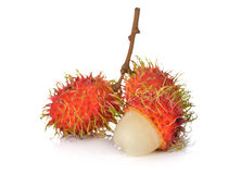 Fresh rambutan with stem on white background. Fresh rambutan with stem on a white background Stock Images