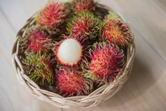 Fresh rambutan sweet delicious in the basket . tropical fruit.  Stock Photos