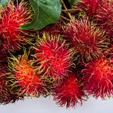 Fresh rambutan. On a white background Royalty Free Stock Images