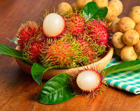 Fresh rambutan and wollongong on wooden background.  Royalty Free Stock Images