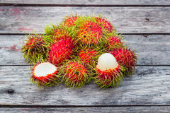 Fresh rambutan. On wood background Stock Images