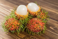 Fresh rambutan on wood. Background Stock Photo