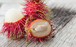 Fresh rambutan on wood texture. Fresh rambutan on wood texture background Stock Photos