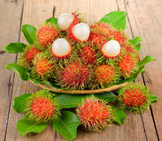 Fresh rambutan on wooden  background Royalty Free Stock Images
