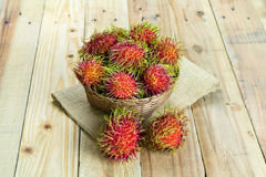 Fresh rambutan. In wooden Basket Royalty Free Stock Photography