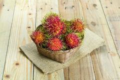 Fresh rambutan. In wooden Basket Stock Photo