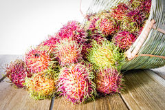 Fresh rambutan in wooden Basket.  Stock Photography
