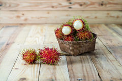 Fresh rambutan. In wooden Basket Royalty Free Stock Images