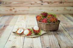 Fresh rambutan. In wooden Basket Stock Photos