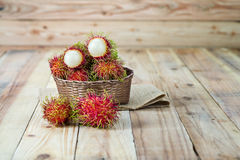 Fresh rambutan. In wooden Basket Stock Images