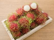 Fresh Rambutan on A Wooden Serving Tray. Fresh Fruits, Top View of Ripe and Sweet Refreshing Rambutan Served on A Wooden Tray Royalty Free Stock Image