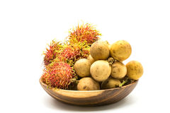 Fresh Rambutans and Longkongs in a wooden bowl. On white background Stock Photography