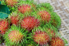 Fresh rambutans. Tropical fruit  on bamboo tray Stock Images