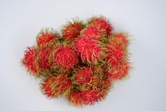 Fresh rambutans on white background. In the rainy season there will be a lot Stock Image