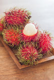 Fresh rambutans on wodden tray Stock Image