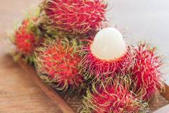 Fresh rambutans on wodden tray Stock Photo
