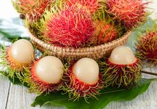 Fresh rambutans in wood bowl. Fresh rambutans in a  wood bowl Royalty Free Stock Photos
