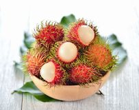 Fresh rambutans in wood bowl. Fresh rambutans in a wood bowl Stock Images