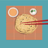 Fresh Ramen noodles. On sushi mat with chopstricks Stock Image