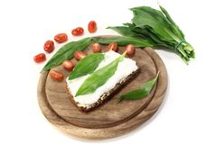 Fresh ramson bread. Slice of bread with fresh cottage cheese, ramson and chopped tomatoes Royalty Free Stock Images