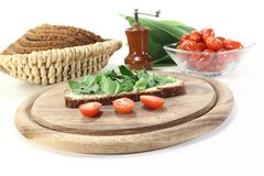 Fresh ramson bread and tomatoes Stock Photo