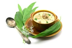 Fresh ramson with garlic soup with meat balls and mushrooms on t. Fresh ramson with garlic soup with meat balls and Agaricus mushrooms on table. bunch of fresh Stock Images