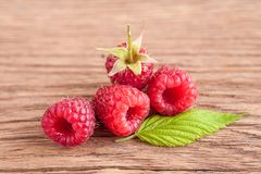 Fresh rasberry on wooden. Background. Natural food Stock Photos