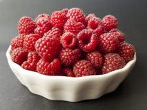 Fresh raspbeeries in a white bowl. Fresh raspbeeries in white bowl Royalty Free Stock Images