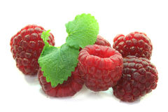 Fresh raspberries. With a leaf on a white background Stock Photo