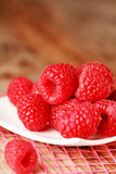 Fresh raspberries. On the plate Royalty Free Stock Images