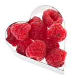 Fresh raspberries. In heart shape isolated over white background Royalty Free Stock Image