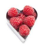 Fresh raspberries. In a heart isolated on white Stock Photography