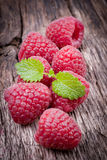 Fresh raspberries. On wooden ground Stock Photography