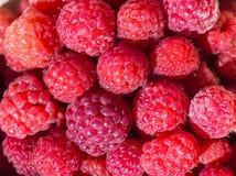 Fresh raspberries background. Fresh raspberries on beautiful background closeup photo Stock Photo